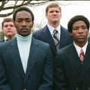 "Nate Ruffin (ANTHONY MACKIE) and Reggie Oliver (ARLEN ESCARPETA) (both center) attend the funeral of a fellow football player in Warner Bros. Pictures' and Legendary Pictures' inspirational drama, ""We Are Marshall,"" distributed by - 454 x 168"