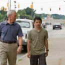 (L-r) Walt Kowalski (CLINT EASTWOOD) and Thao (BEE VANG) in Warner Bros. Pictures' and Village Roadshow Pictures' drama 'Gran Torino,' distributed by Warner Bros. Pictures. Photo by Anthony Michael Rivetti