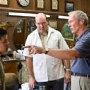 (L-r) Thao (BEE VANG), Martin (JOHN CARROLL LYNCH) and Walt Kowalski (CLINT EASTWOOD) in Warner Bros. Pictures' and Village Roadshow Pictures' drama 'Gran Torino,' distributed by Warner Bros. Pictures. Photo by Anthony Michael Rivetti