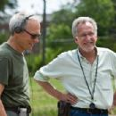 (L-r) Director CLINT EASTWOOD discusses a scene with the director of photography TOM STERN on the set of Warner Bros. Pictures' and Village Roadshow Pictures' drama 'Gran Torino,' distributed by Warner Bros. Pictures. Photo by Anthony Mich