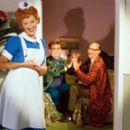 Loes Luca as Nurse Klivia, Paul de Leeuw as Hairdresser Wouter and Paul R. Kooij as Neighbor Boordevol in the musical comedy  'Yes Nurse! No Nurse!' - 400 x 274