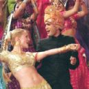 Sharona (Heather Graham) and Ramu (Jimi Mistry) move their feet to the beat of their hearts in an elaborate Bollywood fantasy sequence in Universal's The Guru - 2003