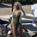 Victoria Silvstedt in Green Swimsuit on the beach in Sardinia - 454 x 629