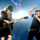 Brian Johnson and musician Angus Young of AC/DC perform at Dodger Stadium on September 28, 2015 in Los Angeles, California. - 454 x 327