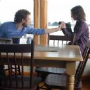 Jack (Kristen Holden-Ried) helps Thomas (Aaron Webber) with camera