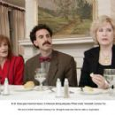 Borat gets important lesson in American dining etiquette. TM and © 2006 Twentieth Century Fox. All rights reserved.