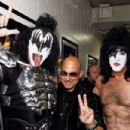 Gene Simmons and Paul Stanley of KISS pose with designer John Varvatos at Fashion Rocks 2014 presented by Three Lions Entertainment at the Barclays Center of Brooklyn on September 9, 2014 in New York City