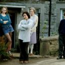 (L to R) Tamsin Egerton as Holly Goodfellow, Kristin Scott Thomas as Gloria Goodfellow, Maggie Smith as Grace Hawkins and Toby Parkes as Petey Goodfellow in Keeping Mum - 2006