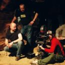 Director Neil Marshall (kneeling, left) on the set of his film THE DESCENT. Photo credit: Alex Bailey