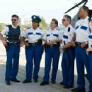 In Miami, Lt. Dangle (Thomas Lennon, left) reviews some strategy with his team: Travis Junior (Robert Ben Garant), Raineesha Williams (Niecy Nash), Cherisha Kimball (Mary Birdsong), James Garcia (Carlos Alazraqui), S. Jones (Cedric Yarbrough), Clementine