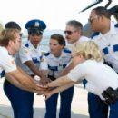 The Reno Sheriffs pump themselves up as they get ready to rid Miami of criminal activity. From left: Lt. Dangle (Thomas Lennon), Travis Junior (Robert Ben Garant), Raineesha Williams (Niecy Nash), Cherisha Kimball (Mary Birdsong), James Garcia (Carlos Ala