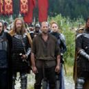 John Rhys-Davies as Merick, Jason Statham as Farmer, Leelee Sobieski as Muriella and Brian J. White as Tarish in the scene of 'In the Name of the King: A Dungeon Siege Tale.'