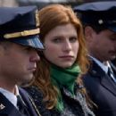 "Megan Egan (LAKE BELL) stands with her husband Jimmy Egan (COLIN FARRELL) during the services of a fallen officer, in New Line Cinema's crime drama ""Pride and Glory,"" distributed by Warner Bros. Pictures. Photo by Glen Wilson"