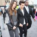 Louis Tomlinson and girlfriend Eleanor Calder at the Topshop Unique Fashion Show during London Fashion Week in London, UK