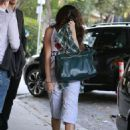 Selena Gomez got her hair chemically straightened today at a hair salon in West Hollywood, California on July 19, 2013 - 454 x 609