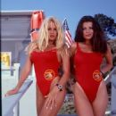 Pamela Anderson as Casey Jean 'C.J.' Parker with Yasmine Bleeth as Caroline Holden in Baywatch.