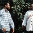 Brian Hooks as Rob Douglas and Faizon Love as Tone, the neighborhood bully, in MGM's 3 Strikes - 2000 - 400 x 265