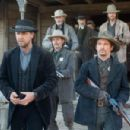 Ben Wade (Russell Crowe, front left), Kane (Chad Brummett, front right), Marshal Weathers (Luce Rains, middle left), Bryon McElroy (Peter Fonda, back left), Dan Evans (Christian Bale, back right), and Glen Hollander (Lennie Loftin, back center) in 3:10 TO