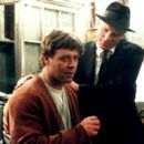 Russell Crowe as John Forbes Nash Jr. and Ed Harris as William Parcher in Universal's A Beautiful Mind - 2001