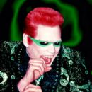 Jim Carrey as The Riddler in Batman Forever - 1995