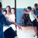 Mrs. Wilkinson's (Julie Walters) zest for teaching is awakened by a new student, Billy Elliot (Jamie Bell), in Universal's Billy Elliot - 2000