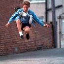 Billy Elliot (Jamie Bell) uses dance as a means of escaping his oppressive surroundings in Universal's Billy Elliot - 2000