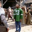 Martin Lawrence as Jamal, a fast-talking con-man who finds himself at swordpoint of the evil knight Percival (Vincent Regan) as Victoria (Marsha Thomason) watches in 20th Century Fox's Black Knight - 2001