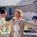 John Carroll Lynch and Swoosie Kurtz as Jimmy's parents and Mitch Holleman as Jimmy at age 4 in Touchstone's Bubble Boy - 2001