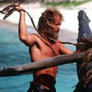 Chuck (Tom Hanks) constructs a raft that will return him to civilization in 20th Century Fox's Cast Away - 2000