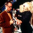 Director John Waters and Melanie Griffith on the set of Artisan's Cecil B. DeMented - 2000