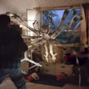 A spider attacks in Warner Bros.' Eight Legged Freaks - 2002