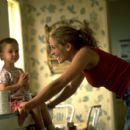 Erin (Julia Roberts) takes care of her child in Universal's Erin Brockovich - 2000