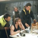 Foreground L-R: Rupert Graves, Devon Sawa and Rufus Sewell Background center: David Scheller in Paramount's Extreme Ops - 2002
