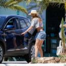 Doutzen Kroes in a cropped top and denim shorts in Ibiza - 454 x 341