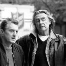 Robert De Niro and director Joel Schumacher on the set of MGM's Flawless - 12/99