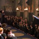 Snape (Alan Rickman) observes Draco Malfoy (Tom Felton) and Harry Potter (Daniel Radcliffe) in Harry Potter and The Chamber of Secrets - 2002