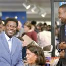 Mitch Gilliam (Bernie Mac, left) shares a laugh with his brother and Presidential candidate Mays Gilliam (Chris Rock, right)