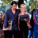John Cusack (left) as Rob Gordon, owner of a semi-failing record store in Chicago. When his long-time girlfriend Laura (Iben Hjejle, right) eventually walks out on him, he examines his failed attempts at romance and happiness in Touchstone's High Fide
