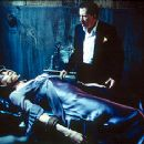 Famke Janssen and Geoffrey Rush in Warner Brothers' House On Haunted Hill - 10/99