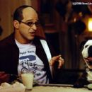 Allen Covert as Todd with Beefy the bulldog (voiced by Robert Smigel) in New Line's Little Nicky - 2000