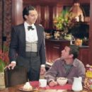 Longfellow Deeds (Adam Sandler, right) confides in his trusty valet, Emilio (John Turturro) in Columbia's Mr. Deeds - 2002