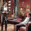 Longfellow Deeds (Adam Sandler, right) jokes with his trusty valet, Emilio (John Turturro) in Columbia's Mr. Deeds - 2002
