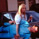 Nurse Betty (Renee Zellweger) carries a cardboard stand-up of Dr. David Ravell (Greg Kinnear) in USA Films' Nurse Betty - 2000