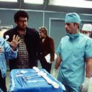 Soap Opera Consultant Shelly Curtis and director Neil LaBute discuss a scene with Greg Kinnear on the set of USA Films' Nurse Betty - 2000