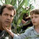 Mel Gibson and Rory Culkin (foreground) and Abigail Breslin and Joaquin Phoenix (background) in Touchstone's Signs - 2002
