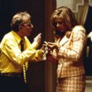 Ray Winkler (Woody Allen) shows his wife Frenchy (Tracey Ullman) the spoils from his latest heist in Dreamworks' Small Time Crooks - 2000 - 400 x 261