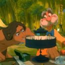 Tarzan is fascinated by the modern gadgetry that Professor Porter has brought with him in Disney's Tarzan - 1999