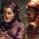 Rosario Dawson and Eddie Murphy in The Adventures of Pluto Nash - 2002