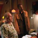 Peter Boyle and Eddie Murphy in The Adventures of Pluto Nash - 2002