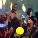 Eddie Murphy and Luis Guzman in The Adventures of Pluto Nash - 2002